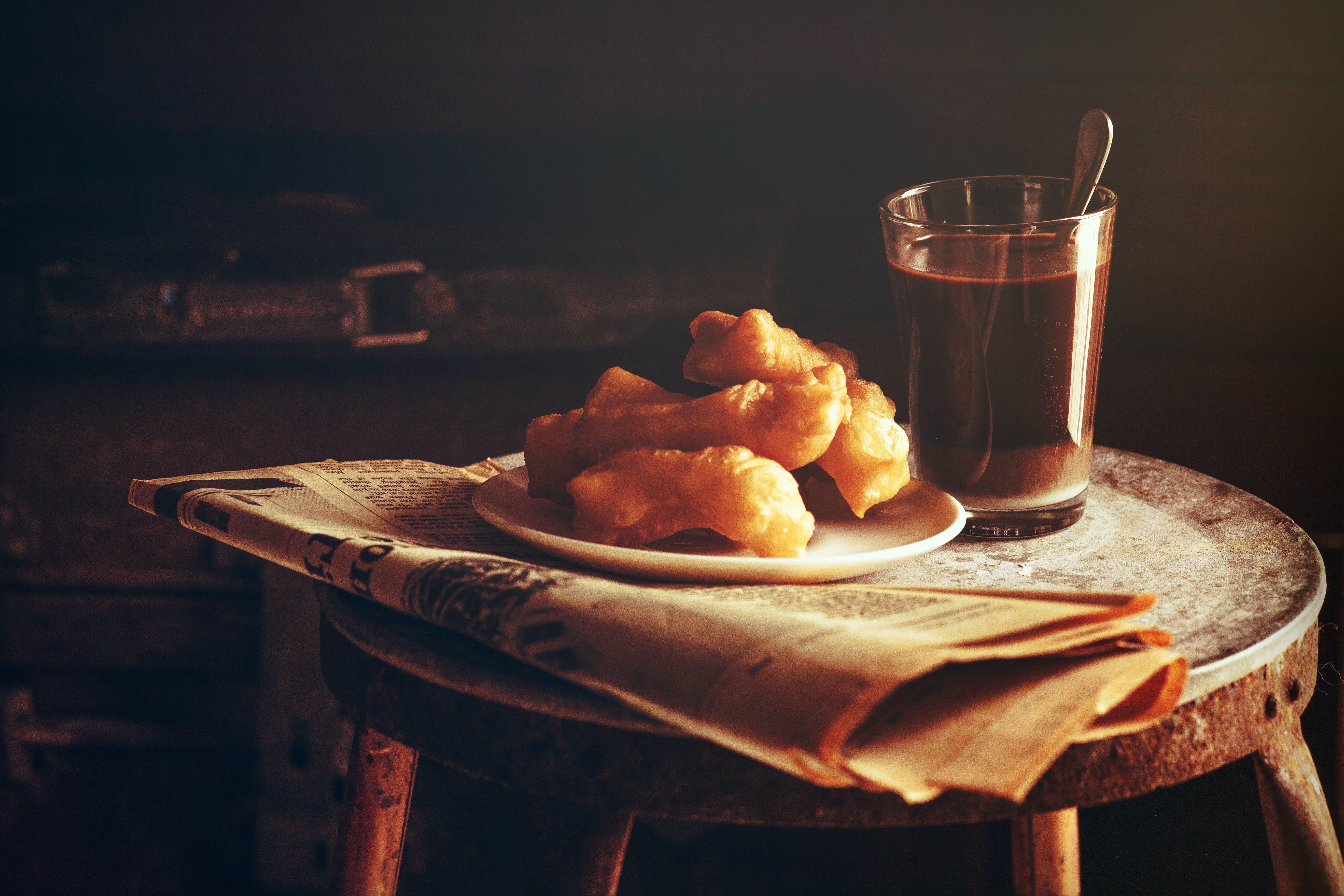 Coffee Beside Plate of Bread