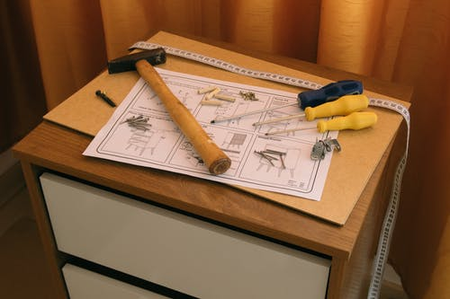 Tools and paper instruction for furniture assembly