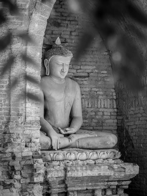 Grayscale Photo of a Buddha Statue