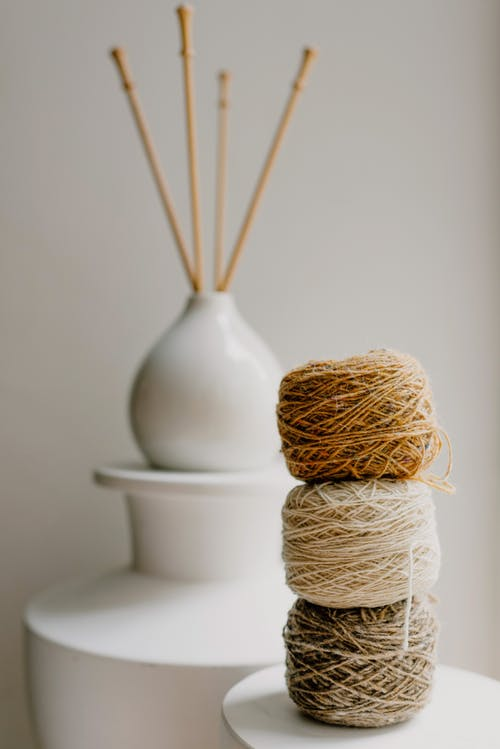 Close-Up Shot of Stack of Assorted Rolled Sewing Threads