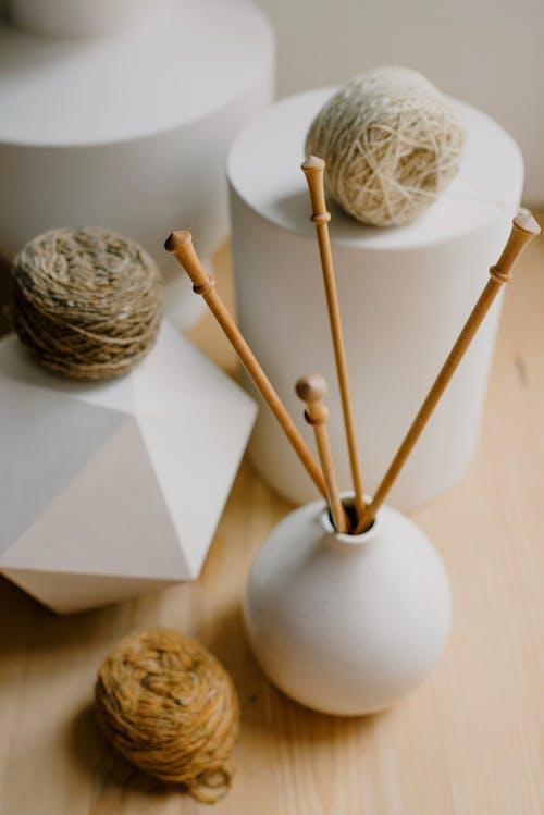 Close-Up Shot of Yarns and Crochet Hooks