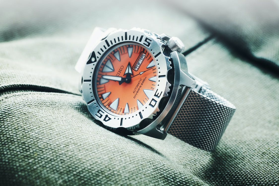Round Orange and Silver-colored Seiko Analog Watch Showing 1:57