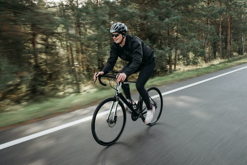 A Cyclist Riding a Bike on the Road