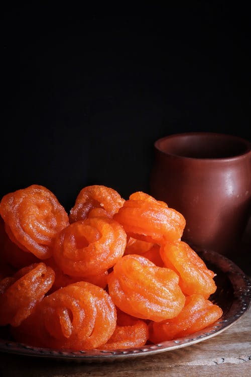 Orange Fruits on Black Ceramic Bowl