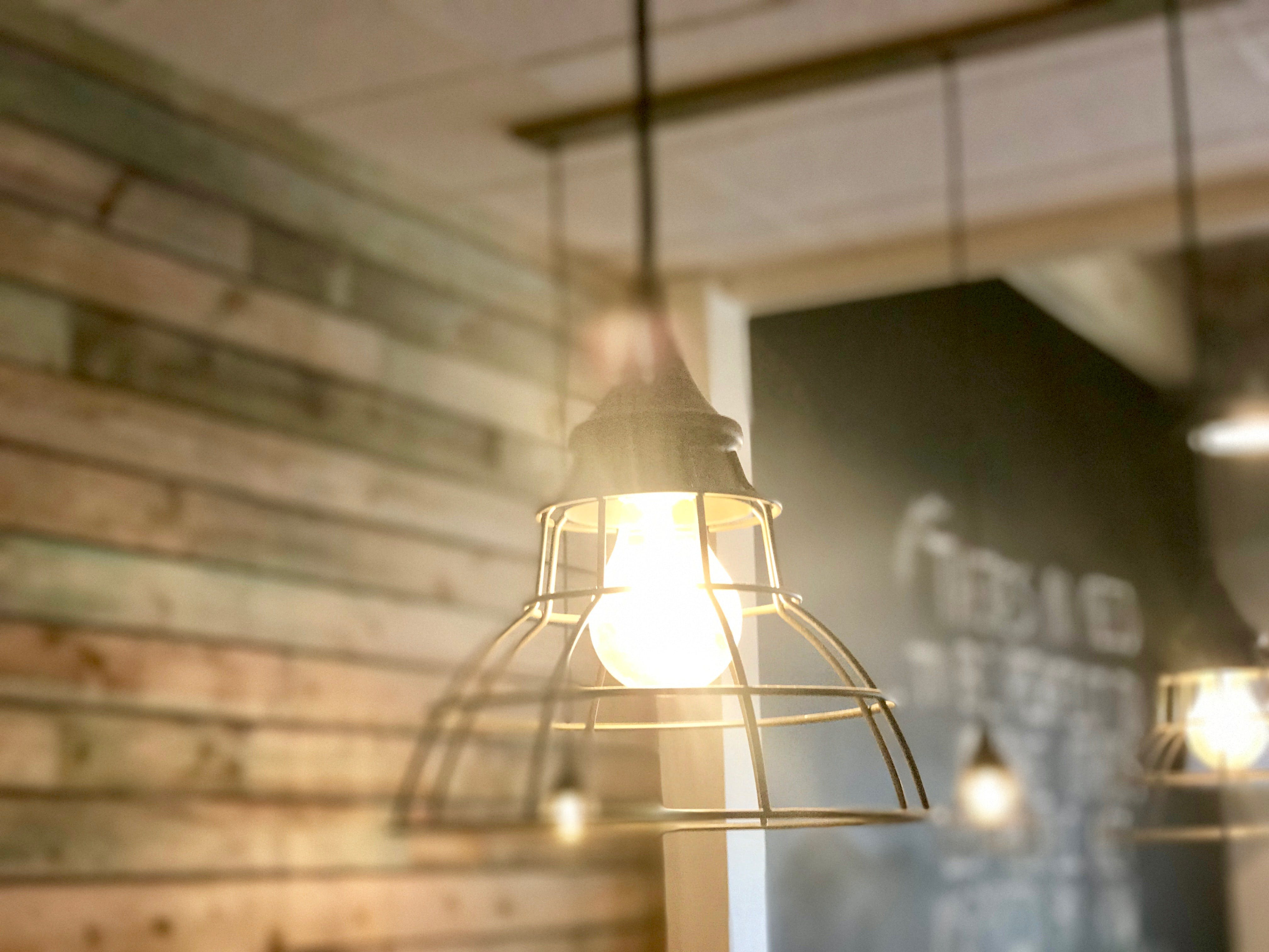Turned-on Gray Metal Framed Pendant Lamp