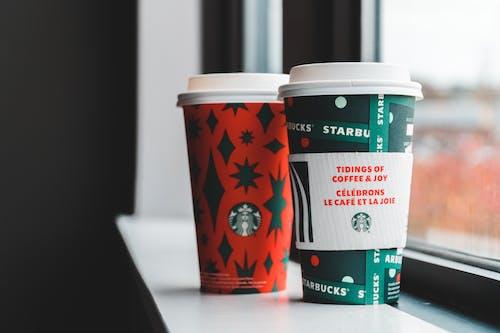 Cups for takeaway coffee on windowsill