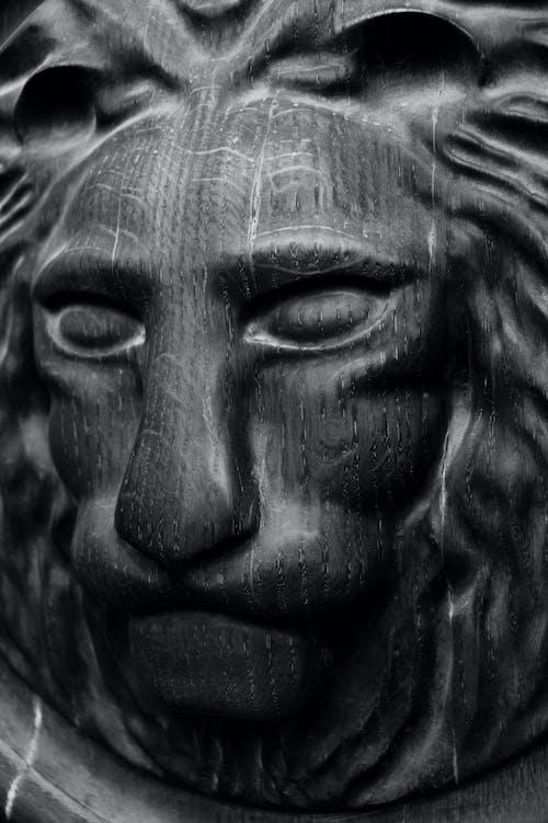 Old carved metal lion head sculpture
