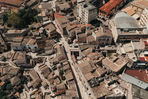 Aerial view of aged stone residential houses located in living district of old town