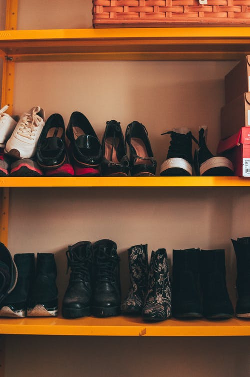 Shoe rack with many pairs of shoes