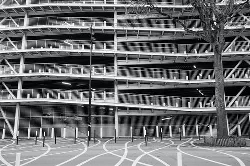 Grayscale Photo of a Parking Building