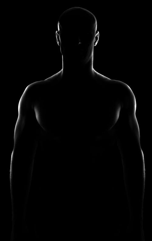 Topless Man in Black Background