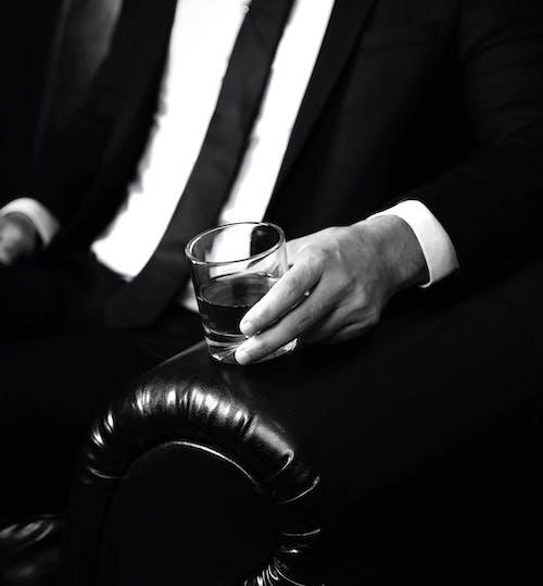 Man in Black Suit Jacket and Black Necktie