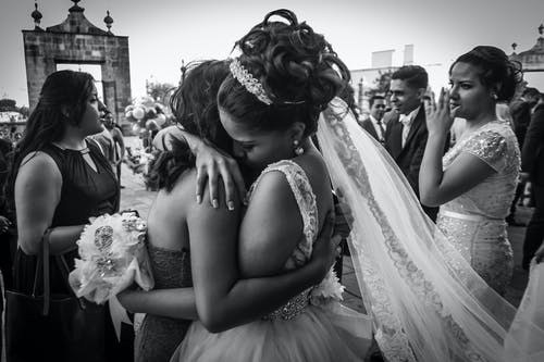 Grayscale Photo of Bride and Groom Kissing