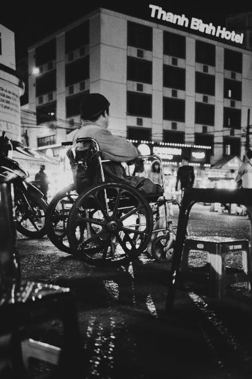 Unrecognizable people on street near building