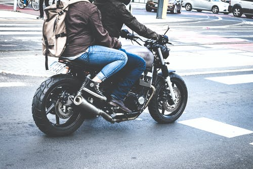 Two Person Riding Gray Cafe Racer