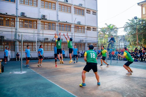 Group of Men Playing Volleyball