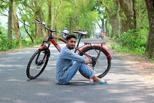 Girl in Blue Denim Jeans Sitting on Road Bike