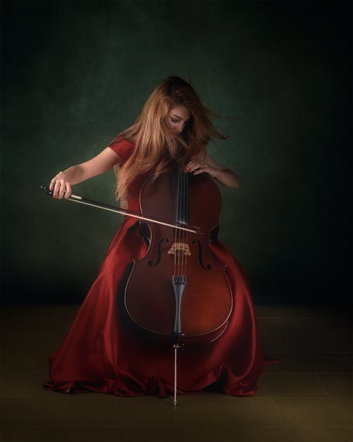 Woman in Red Dress Playing Cello