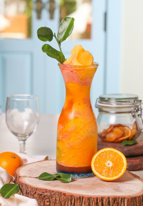 Orange Juice on Clear Glass Container