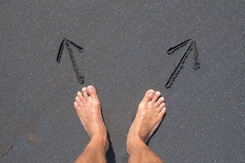 Person Standing on Black Floor