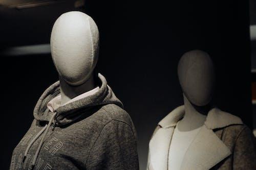 Mannequins in apparel in dark showcase