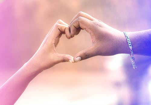 Two Persons Forming Heart by Hands