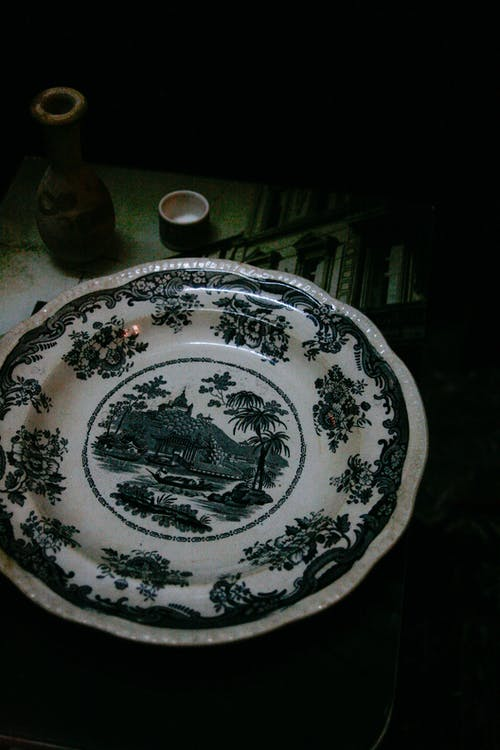 Ceramic plate with ornament near jug on table