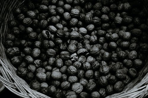 Pile of whole walnuts in wicker basket