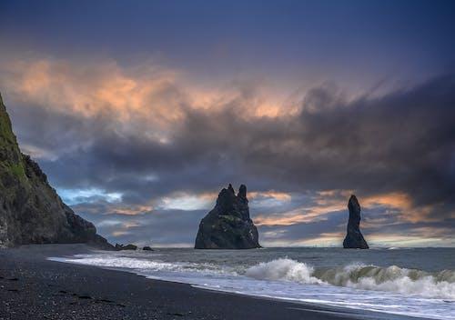 Foto profissional grátis de areia, beira-mar, céu