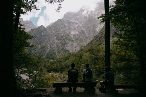 Travelers on bench in rocky mountains