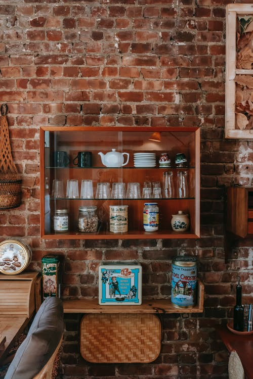 Interior of vintage kitchen with classic wooden furniture and dishware