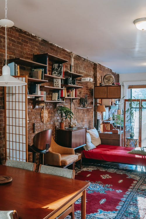 Cozy room with brick wall and vintage furniture