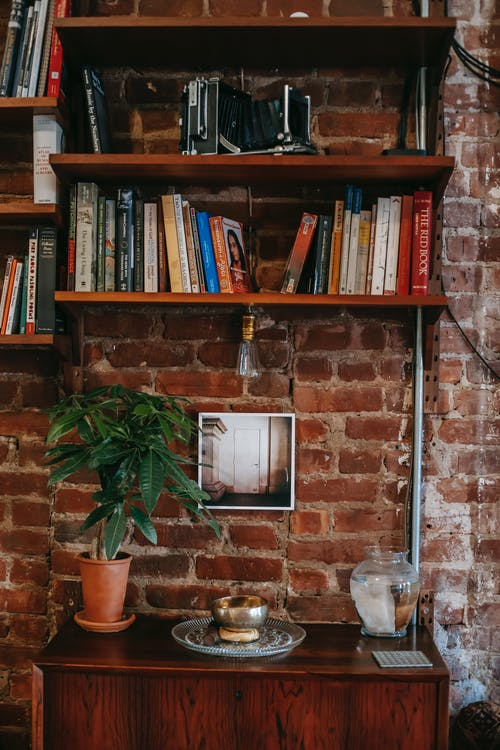 Bookshelves on brick wall in room