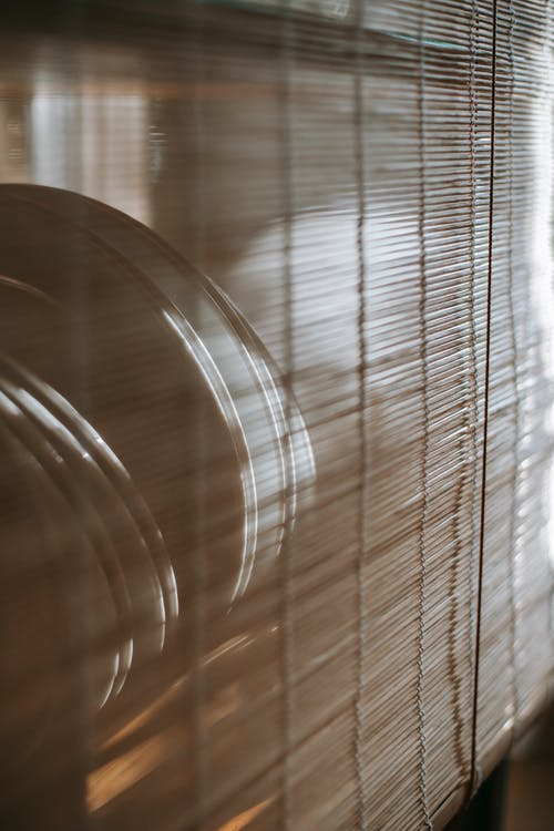 Plates placed behind curtain in apartment