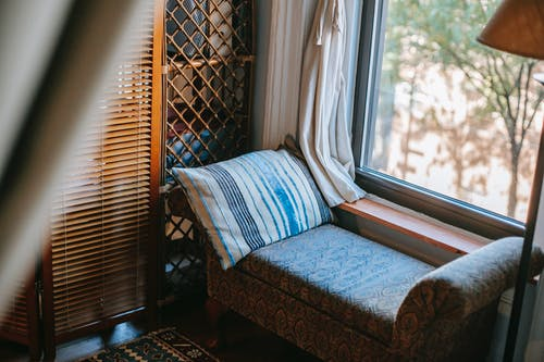 Cozy room with sofa near window