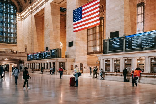 Interior of classic Grand Central Terminal building with brick columns and ornamental walls over parquet on floor
