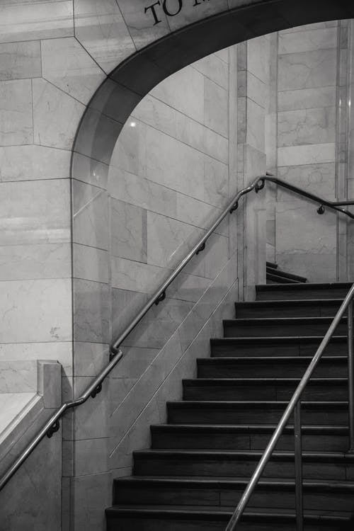 Staircase with metal railings in stone building
