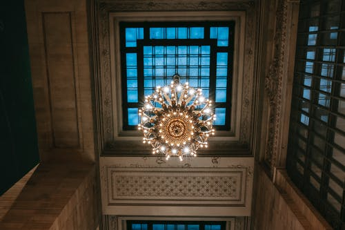 Classic ceiling with majestic chandelier on window
