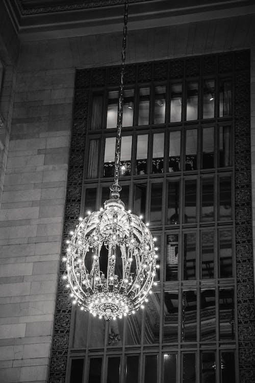 Majestic chandelier on ceiling near window