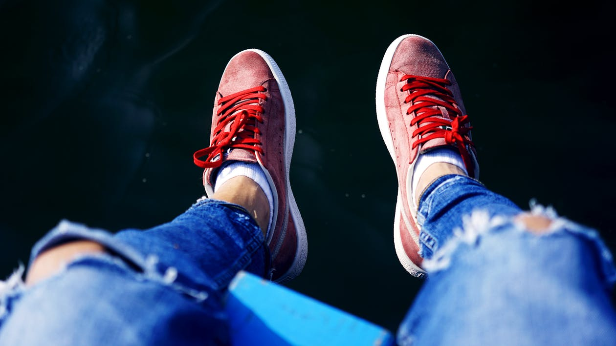 Person Wearing Pair of Red Low-top Sneakers