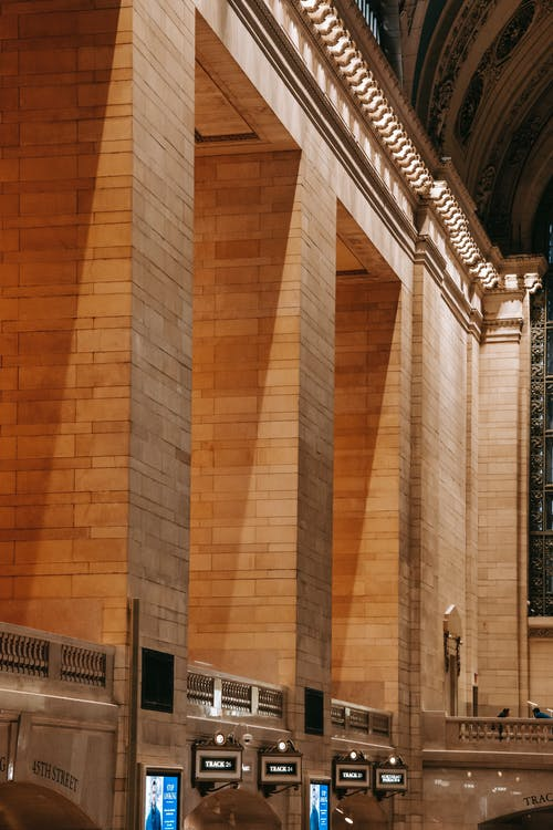 Shadow on wide brick columns located in spacious hall