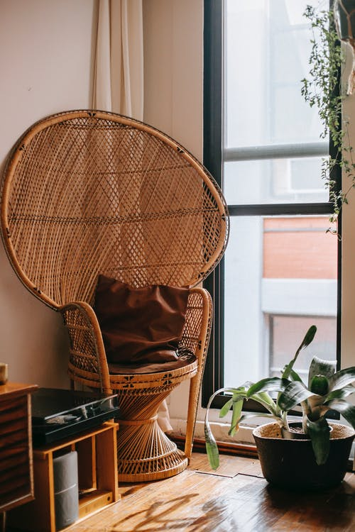Cozy interior with wicker chair in corner