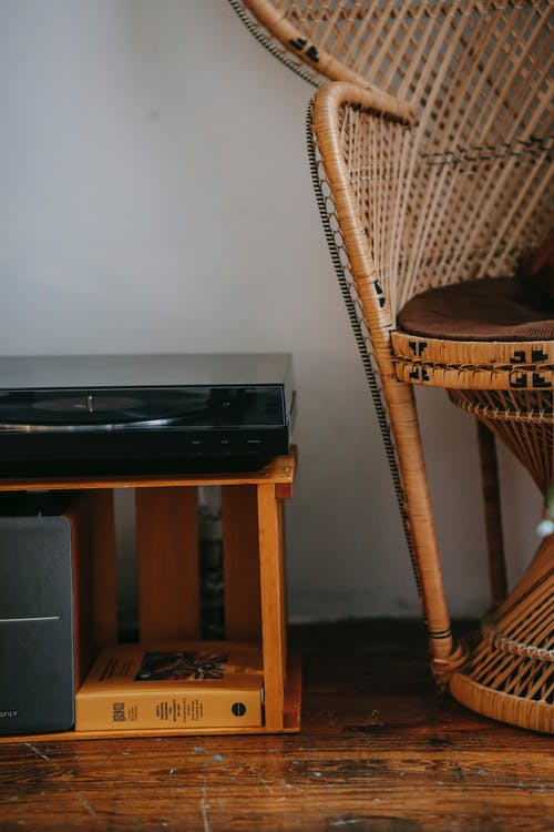 Retro vinyl player near chair