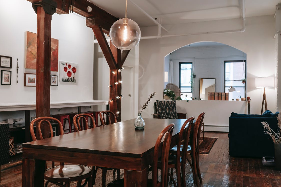 Dining table near wooden beam