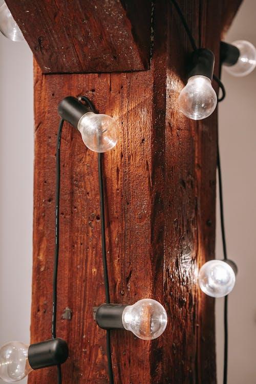 Glowing lamps on wooden board