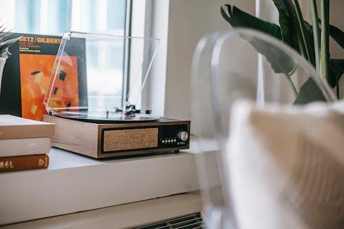 Retro record player on windowsill at home