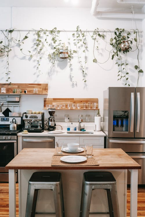 Kitchen and dining area in Scandinavian style located in cozy apartment