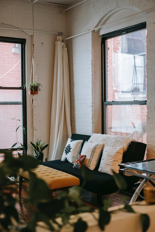 Interior of cozy apartment with big window