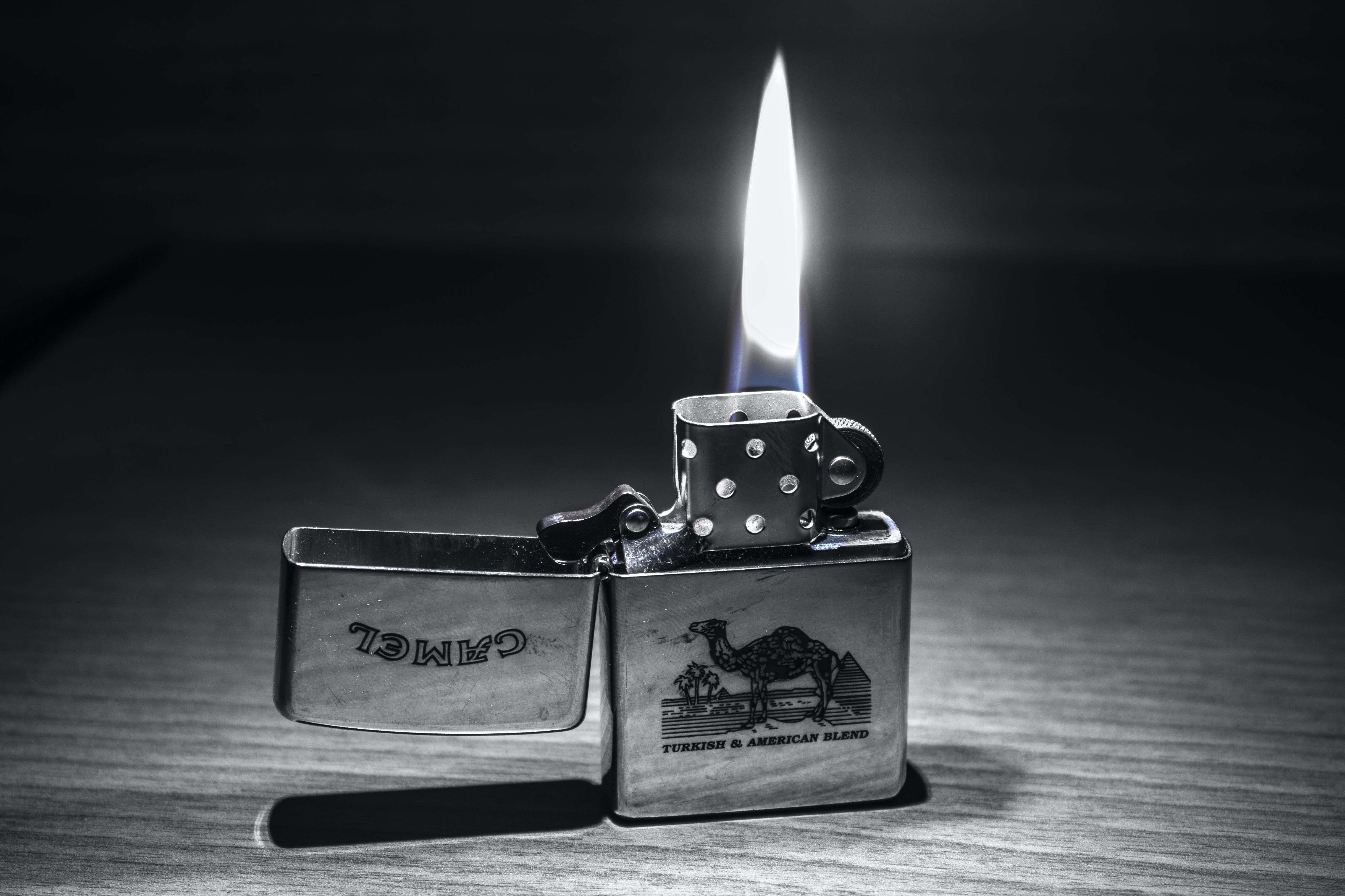 Grayscale Photography of Camel Flip Lighter