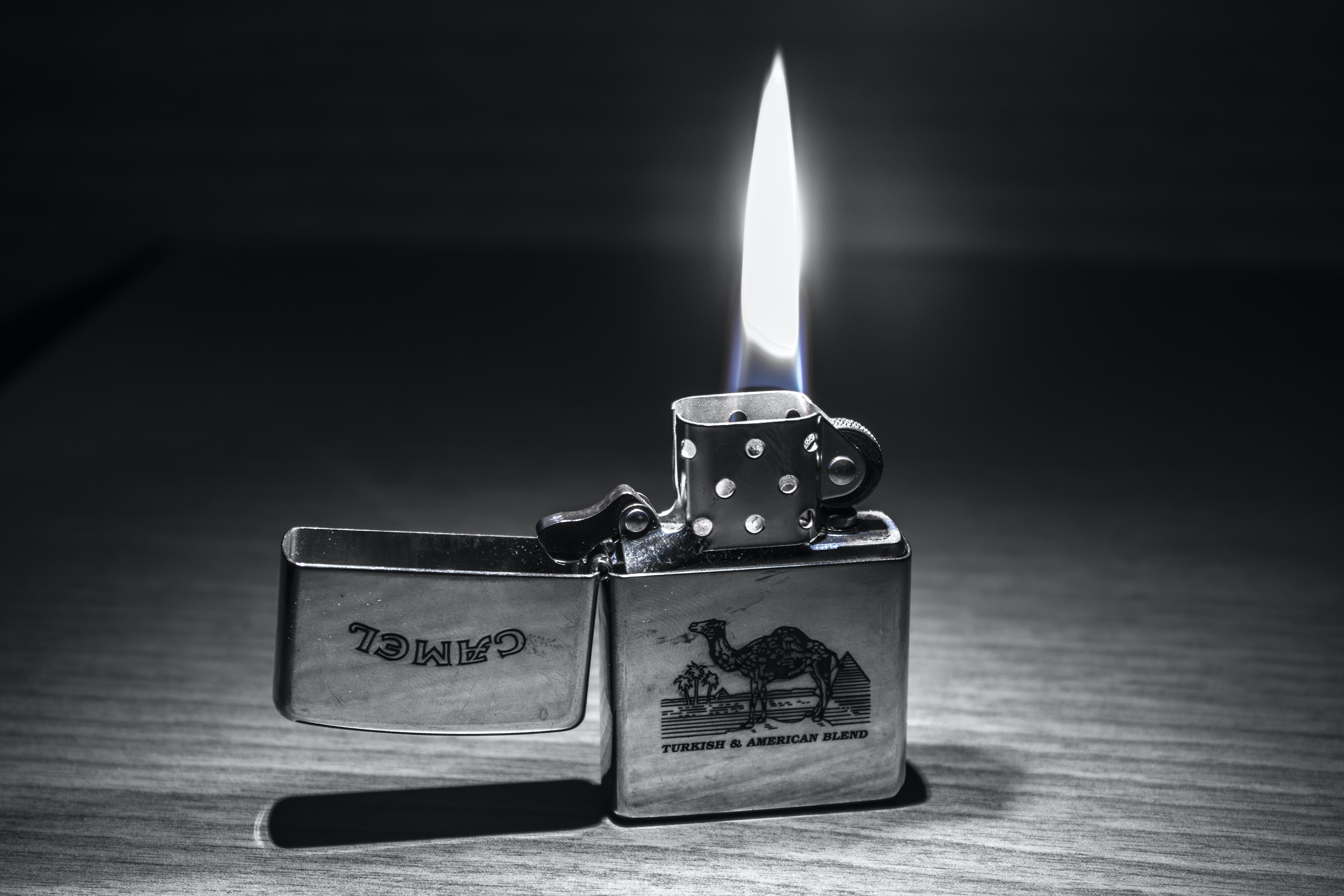 Grayscale photography of camel flip lighter · free stock photo